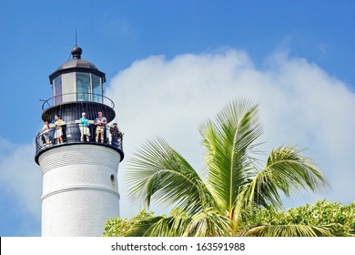 KEY WEST - NOV. 26, 2010: Tourists climb the decommissioned Key West lighthouse to the observation deck Thanksgiving weekend 2010.  Decommissioned in 1969 today it is preserved as a tourist attraction.