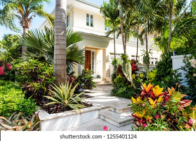 Key West, USA - May 1, 2018: Luxury modern entrance architecture of house in Florida city island on travel, sunny day, property real estate with garden landscaping decoration steps