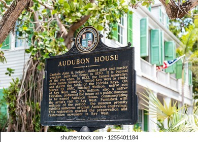 Key West, USA - May 1, 2018: Audubon house historic landmark on street architecture with tourist information sign closeup in Florida city travel, sunny day