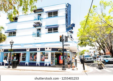 Key West, USA - May 1, 2018: People walking by Pegasus hotel sign vintage retro art deco architecture blue and white color in Florida city travel, sunny day, street, cars in traffic