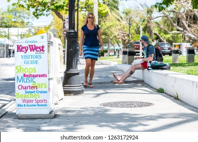 Key West, USA - May 1, 2018: Gratis newsstand, magazine, newspaper, visitors guide, street, road in Florida keys, people, tours, tourist activities, bars, restaurants, beaches, music, rentals