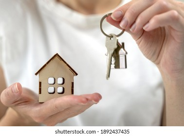 the key to your own home in the palm of the girl and a wooden ho