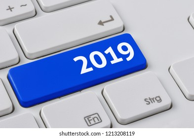 A keyboard with a blue button - 2019