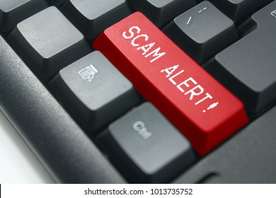 keyboard button with word scam alert
