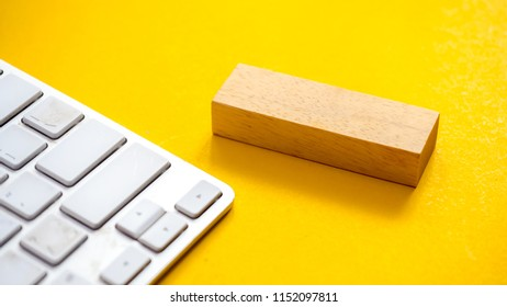 keyboard cand wood block lose up on yellow background