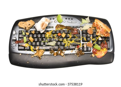 A keyboard covered with food remnants. We all know we're guilty of eating while on the computer and dropping crumbs.  This is an exaggerated example.