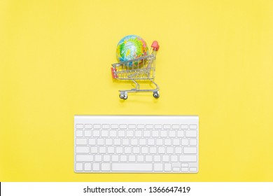 keyboard, earth and shopping trolley, minimalist concept