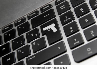 Keyboard with a gun on the enter key. Online bullying kills.