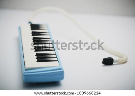 Keyboard Harmonica On White Background Stock Photo (Edit Now