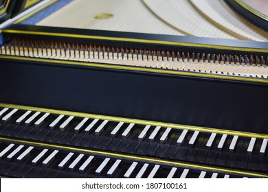 Keyboard of harpsichord (selective focus), Detail on a harpsichord keyboard. Baroque musical instrument.