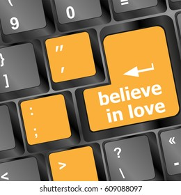 keyboard key with believe in love text and arrow