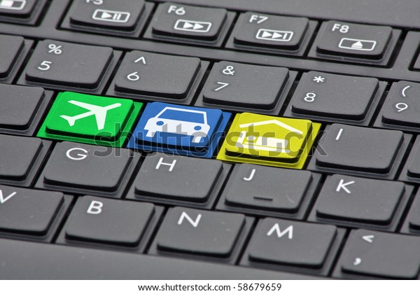 Keyboard with keys to book flight, rental car and hotel - online booking concept
