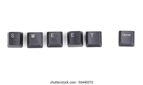 Keyboard keys saying sweet home isolated on white