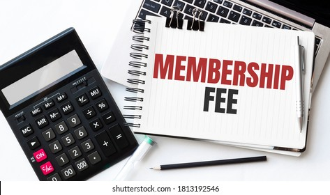 Keyboard of laptop, calcualtor, pencil and notepad with text MEMBERSHIP FEE on the white background