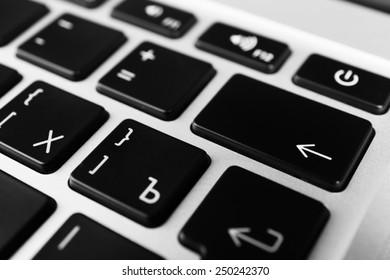 Keyboard of modern laptop close up