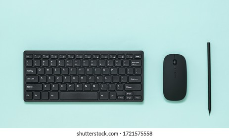 Keyboard, mouse and black pencil on a light background. Peripheral devices for computers.
