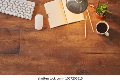 keyboard mouse and notebook with coffee on the old wood table empty area for advertisement