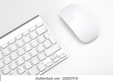 Keyboard and mouse on a white background, close-up
