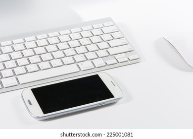 Keyboard mouse and smartphone isolated on white background