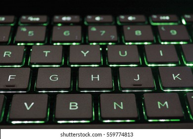Keyboard for notebook. English keyboard with green light. Hacker keyboard. Neon light. Keyboard for developers and hackers