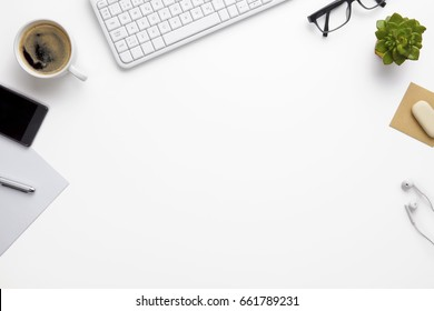 Keyboard With Office Supplies On White Desk