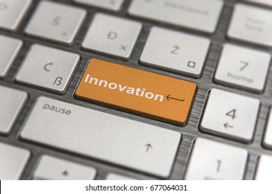 Keyboard with orange key Enter and word Innovation button modern pc text communication board