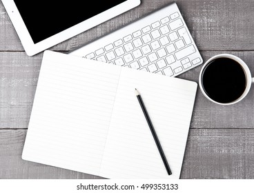 Keyboard with pencil and  coffee cup and tablet on office desk