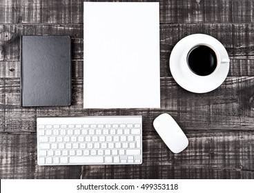 Keyboard with phone paper sheet and coffee cup on office desk