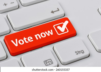 A keyboard with a red button - Vote now