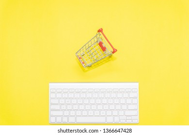 keyboard and shopping trolley, minimalist concept