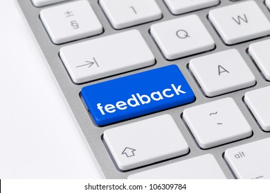 Keyboard with single blue button showing the word feedback
