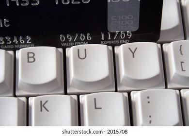 Keyboard with the word buy spelt on keys plus Credit Card