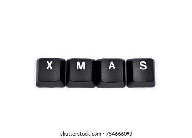 Keyboard Xmas stock images. Xmas inscription. Computer keyboard Xmas button. Keyboard buttons on a white background