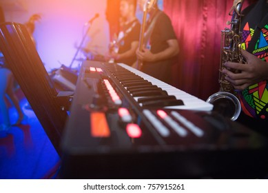 Keyboards and musicians are playing concerts. (soft focus)