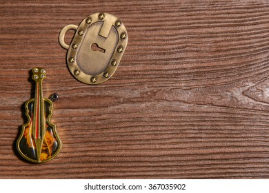 Keychain bass Lighter and key lock on a wooden background