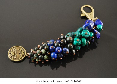 Keychain for car or bag on black background.