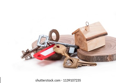 Keychain in the form of a house and different shapes of keys