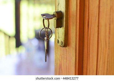Keyhole with keys. Unlocking the door.