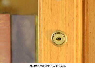 keyhole on door of wooden bookcase