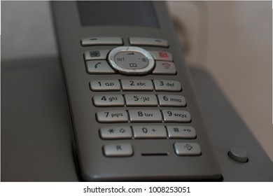 "Keypad of a DECT phone with the ""missed-call-light"" flashing"
