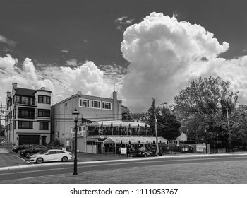 KEYPORT, NEW JERSEY - JUNE 2 - A large cumulonimbus cloud as seen over this neighborhood on June 2 2018 in Keyport New Jersey.