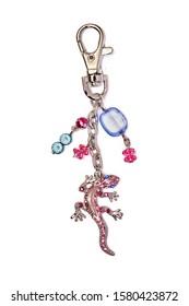 keyring gekko with glass beads isolated on white background
