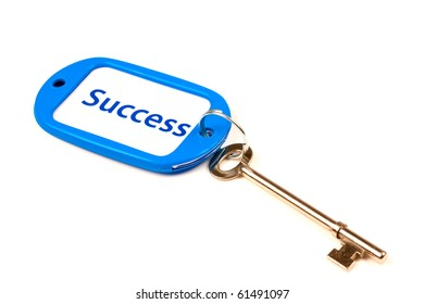 A Keyring with Success printed on it attached to a key