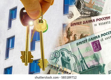 The keys to the apartment in the background of the facade of the house and money . ?he concept of sales in the real estate market .