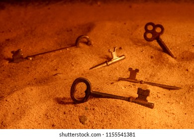 Keys buried in the sand