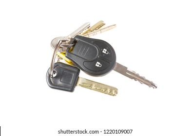 Keys from car and house on keyring isolated on white background