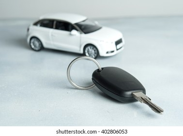 keys and car on white background. Car insurance. Automobile collision damage waiver concepts. with protective gesture and icon of car. Protection of car. Business concept.