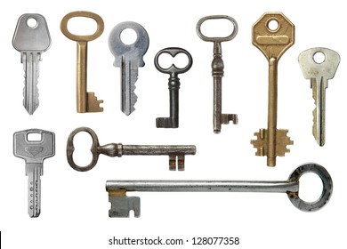 Keys from door locks on a white background.