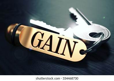 Keys to Gain - Concept on Golden Keychain over Black Wooden Background. Closeup View, Selective Focus, 3D Render. Toned Image.