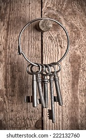 Keys hanging on wooden wall